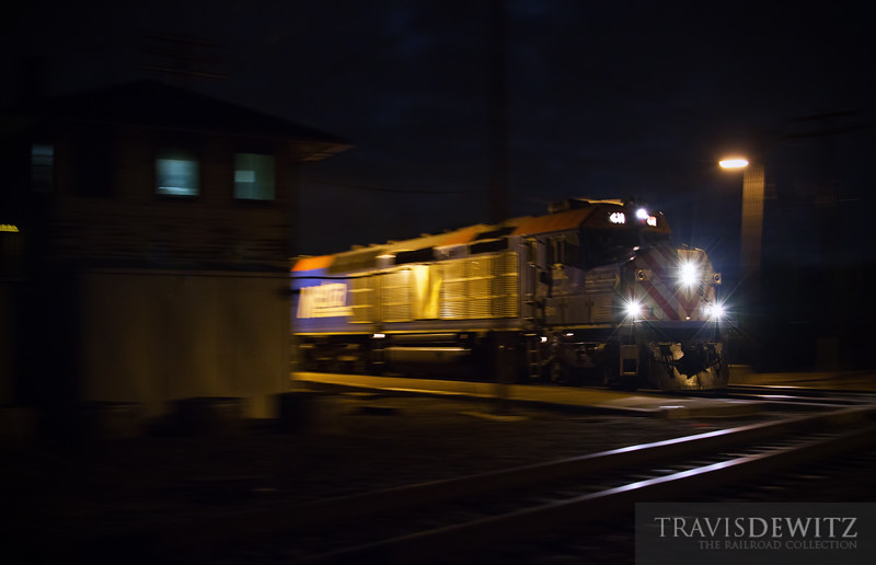 """Metra 611, one of only two remaining Metra EMD F40C passenger locomotives, flies across the diamond at Rondout Tower with passengers going from Chicago to Fox Lake, WI.  Travis Dewitz <a href=""""http://www.therailroadcollection.com/latest-works/"""" target=""""_blank"""">The Railroad Collection</a>"""