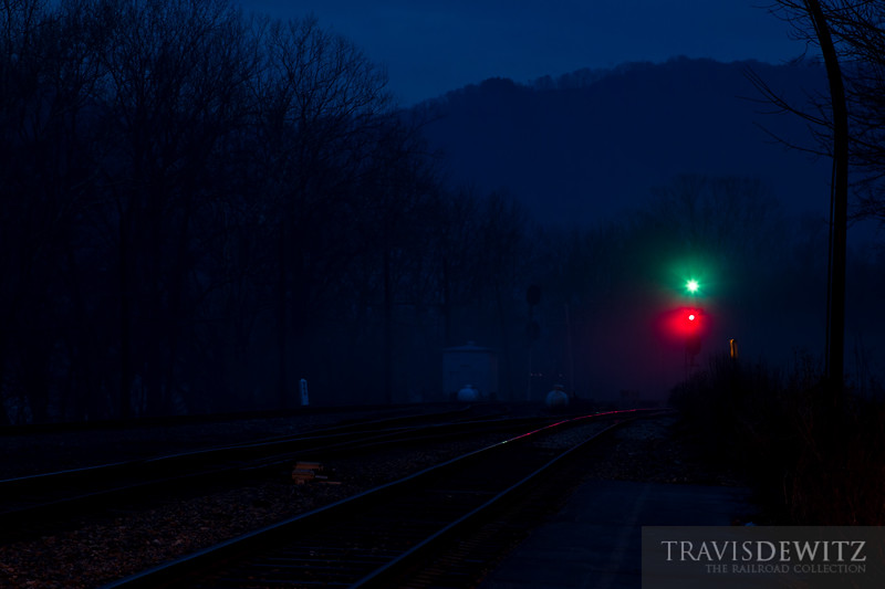 Signals stand gaurd at dusk on the CSX New River Division at Prince, West Virginia.