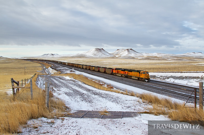 """Fresh black coal top off the many hopper car being pulled north towards Donkey Creek Junction. Fresh snow adds a white coat to the cold Wyoming landscape.  Travis Dewitz <a href=""""http://www.therailroadcollection.com/latest-works/"""" target=""""_blank"""">The Railroad Collection</a>"""