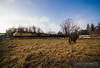 A Wisconsin Northern frac sand train rolls past a small pasture with a couple of horses just south of New Auburn, Wisconsin.