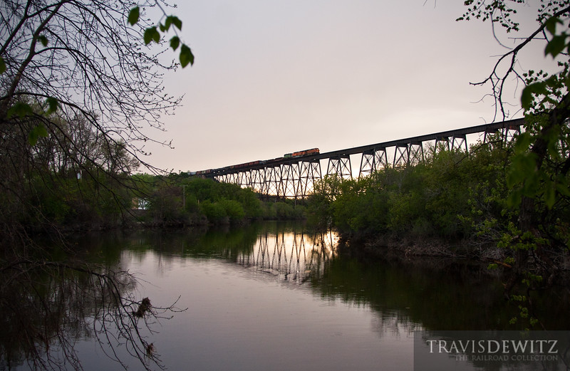 """BNSF 7463 leads a freight east across the Highline Bridge over the Sheyenne River. The town of Valley City, ND is still recovering from the flood that over took the Sheyeene's banks.  Travis Dewitz <a href=""""http://www.therailroadcollection.com/latest-works/"""" target=""""_blank"""">The Railroad Collection</a>"""