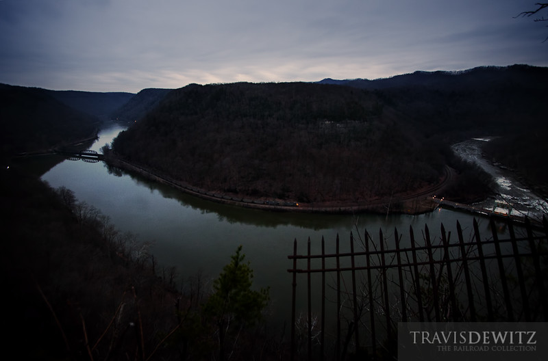 """In the early morning hours a CSX coal train creeps along the New River as the sun's rising light just starts to fall into this West Virginia hollar.  Travis Dewitz <a href=""""http://www.therailroadcollection.com/latest-works/"""" target=""""_blank"""">The Railroad Collection</a>"""