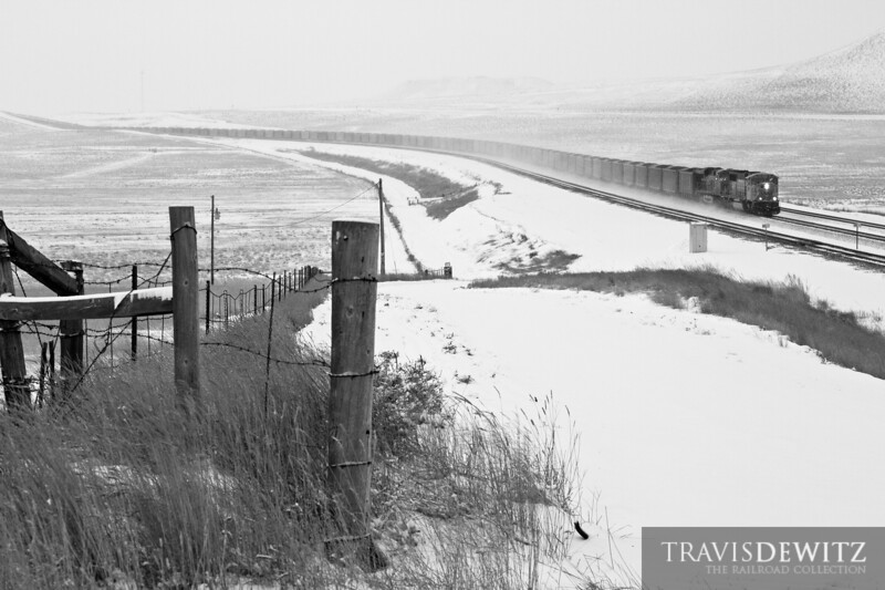 A snowy morning covers the landscape in white as BNSF 9911 heads up the Orin Sub towards Gillette, Wyoming.