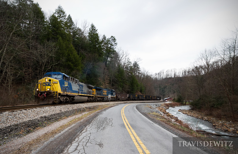 CSX 324 lead an empty RJ Corman coal train up the valley from Thurmond, West Virginia to Pax.