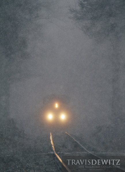 Very heavy snowfall creates a dream like world as CSX 5006 comes through the tunnel of trees near Pax, West Virginia.