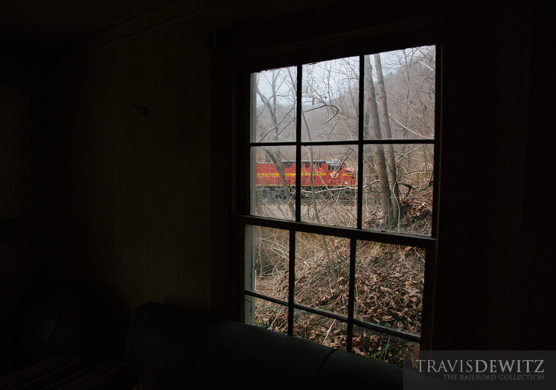 Norfolk Southern heritage unit 8114 can be seen through a window of an abandoned Switchback, West Virginia church as it pushes a coal train towards Bluefield on the Pocahontas district.