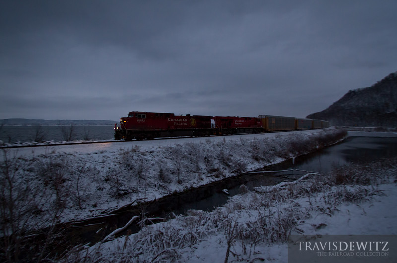 """A Canadian Pacific train heads up the River Sub towards St. Paul along a cold Mississippi River.  Travis Dewitz <a href=""""http://www.therailroadcollection.com/latest-works/"""" target=""""_blank"""">The Railroad Collection</a>"""