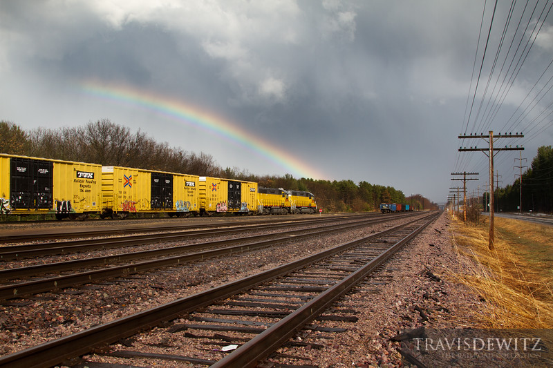 """The strong fast moving storm cell just cleared overhead allowing the sun to shine in. The work resumes in the Altoona yard under an incredible rainbow.  Travis Dewitz <a href=""""http://www.therailroadcollection.com/latest-works/"""" target=""""_blank"""">The Railroad Collection</a>"""
