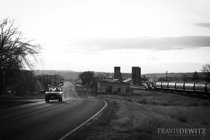 A typical days scene for Park City, Montana as a BNSF grain train works against the rising sun.