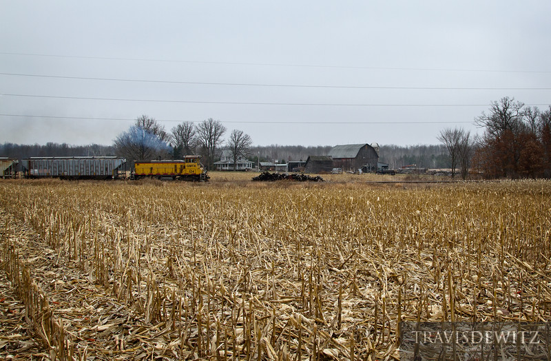 "Looks like a scene from the past as a Wisconsin Northern train  pulls hard on past a old farm homestead heading south near Tilden, Wisconsin.  Travis Dewitz <a href=""http://www.therailroadcollection.com/latest-works/"" target=""_blank"">The Railroad Collection</a>"