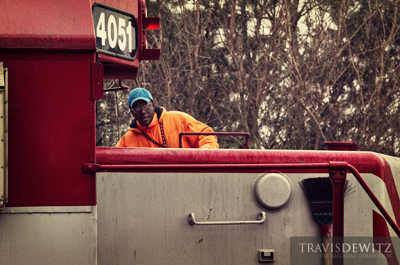 "Conductor Montgomery climbs aboard Wisconsin & Southern SD40-2 4051 in a light rain just outside of Zenda, Wisconsin.  Travis Dewitz <a href=""http://www.therailroadcollection.com/latest-works/"" target=""_blank"">The Railroad Collection</a>"