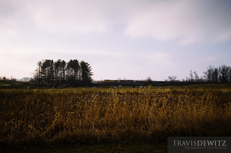 A Wisconsin Northern frac sand train rolls across farm fields as it heads south to the Union Pacific interchange at Chippewa Falls.