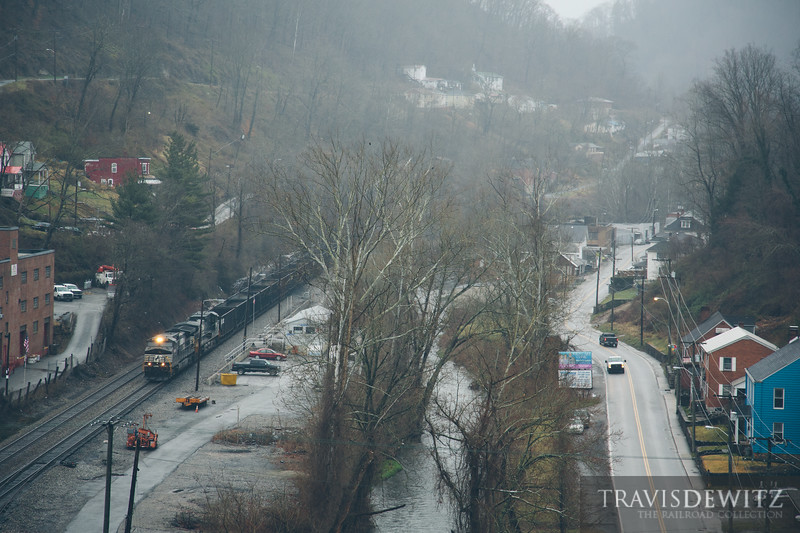 Overlooking down Welch, West Virginia on this foggy March morning as an empty Norfolk Southern coal train travels west.