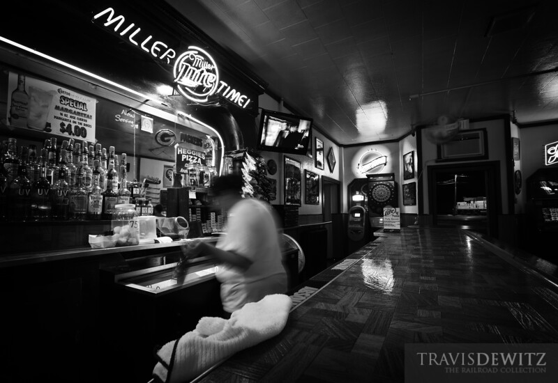 """The bartender reaches into the cooler for a cold one at the """"400"""" Club in Altoona, Wisconsin which was named after the famous Chicago and Northwestern passenger train that used to pass right by the front door.  Travis Dewitz <a href=""""http://www.therailroadcollection.com/latest-works/"""" target=""""_blank"""">The Railroad Collection</a>"""