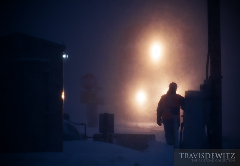 """The BNSF local out of La Crosse is toughing out the blizzard switching the sand plant in Maiden Rock, WI. A couple of MOW workers arrived early to clean snow out of the switches and stayed to help protect the crossing and anything else that may be needed, with this heavy snowfall and high winds.  Travis Dewitz <a href=""""http://www.therailroadcollection.com/latest-works/"""" target=""""_blank"""">The Railroad Collection</a>"""