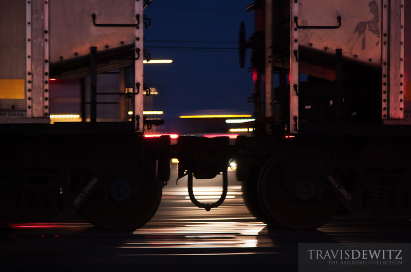 "Coal Cars fly by a crossing in Superior, WI.  Travis Dewitz <a href=""http://www.therailroadcollection.com/latest-works/"" target=""_blank"">The Railroad Collection</a>"