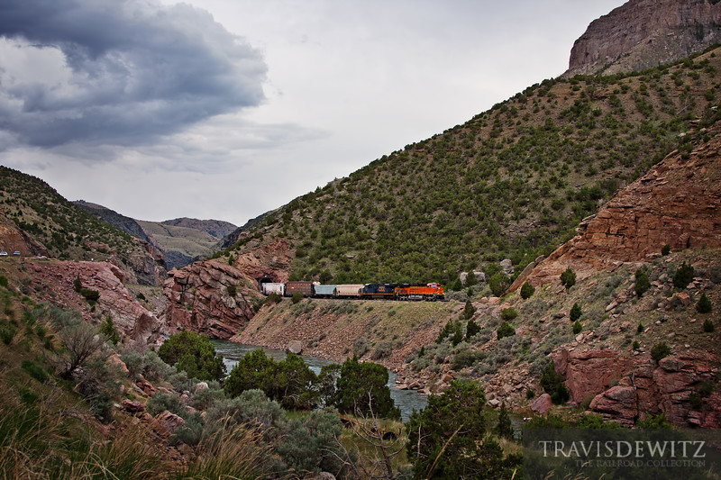 "BNSF 7222 leads out of one tunnel and into the next as it works north through the Wind River Canyon towards Thermopolis, Wyoming.  Travis Dewitz <a href=""http://www.therailroadcollection.com/latest-works/"" target=""_blank"">The Railroad Collection</a>"