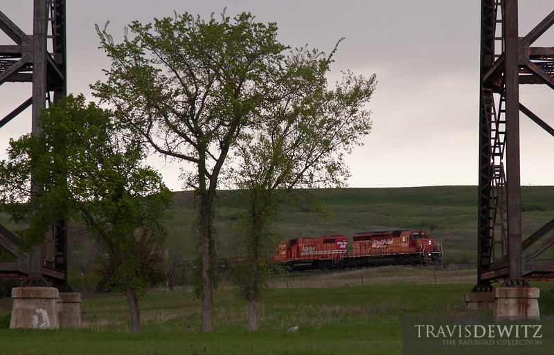 """Canadian Pacific SD40-2 leads a train east on the Carrington Subdivision under the BNSF Jamestown Subdivision in Valley City, ND.  Travis Dewitz <a href=""""http://www.therailroadcollection.com/latest-works/"""" target=""""_blank"""">The Railroad Collection</a>"""