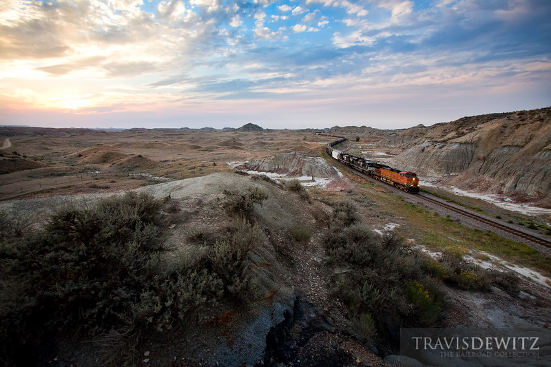 The sky lights up late in the day as BNSF 4839 leads with a duo of Norfolk Southern units through the Badlands of North Dakota near Sully Springs.