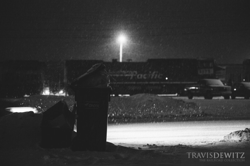 Snow falls over western Wisconsin as an Union Pacific train waits to depart from the Altoona yard.