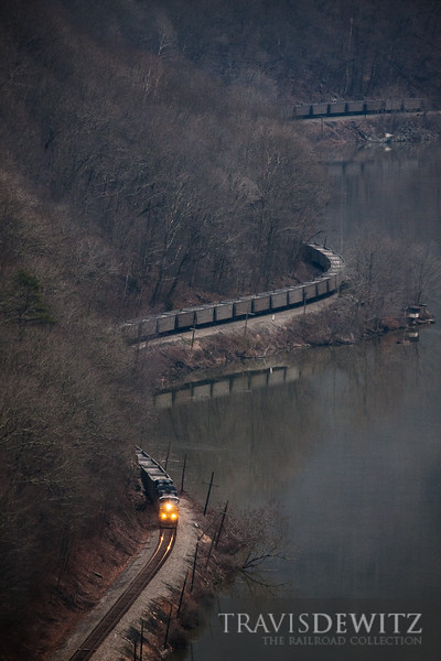 CSX train slowly snakes through the New River Gorge in the early morning hours.