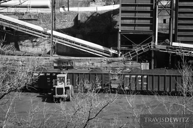 A Cat front end loader loads coal in to Norfolk Southern coal hoppers at Superior, West Virginia.