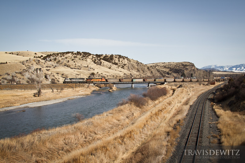 A BNSF led coal train heads west across the East Gallatin River at Logan, Montana.