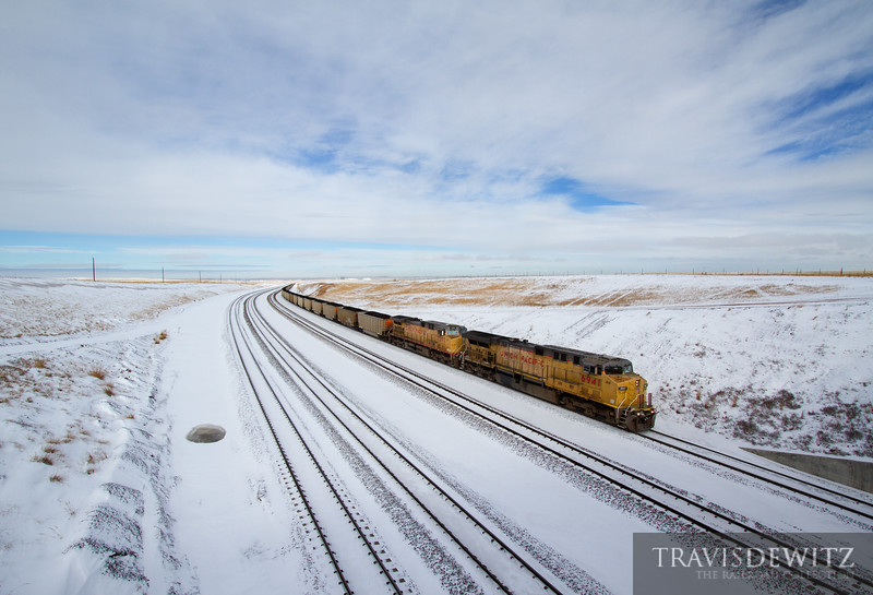 """Fresh snow and the bright sun makes the crest of Logan Hill look like a Winter Wonderland as a Union Pacific coal train works south towards Bill, Wyoming.  Travis Dewitz <a href=""""http://www.therailroadcollection.com/latest-works/"""" target=""""_blank"""">The Railroad Collection</a>"""