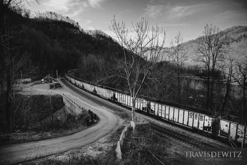 A string of aluminum CSX hoppers sail by along the New River near Cotton Hill, West Virginia.