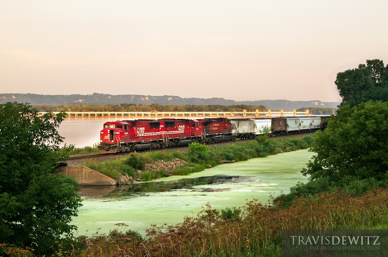 """A pair of Soo Line SD60Ms work up the River Sub with Mississippi River Lock and Dam #5 in the background.  Travis Dewitz <a href=""""http://www.therailroadcollection.com/latest-works/"""" target=""""_blank"""">The Railroad Collection</a>"""