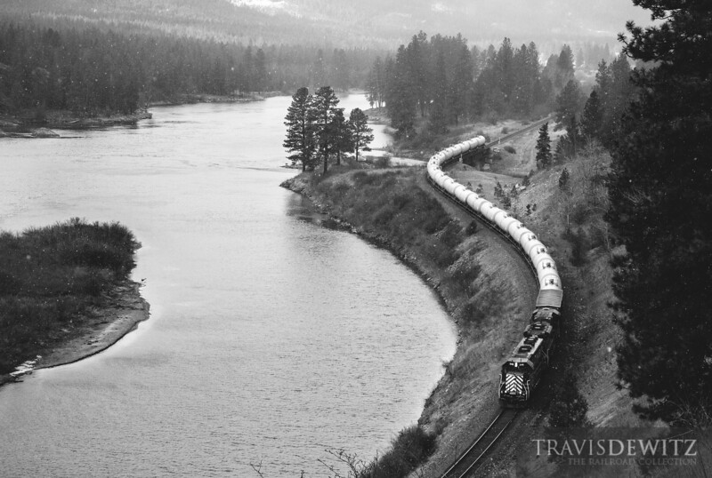 The gas local has just departed Thompson Falls and are on their way east to Missoula as they skirt along the Clark Fork.