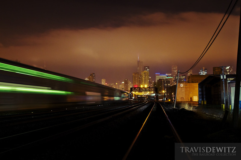 "An inbound Metra passenger train flies towards Chicago Union Station as a low cloud base hangs just above the downtown skyline including Willis Tower.  Travis Dewitz <a href=""http://www.therailroadcollection.com/latest-works/"" target=""_blank"">The Railroad Collection</a>"