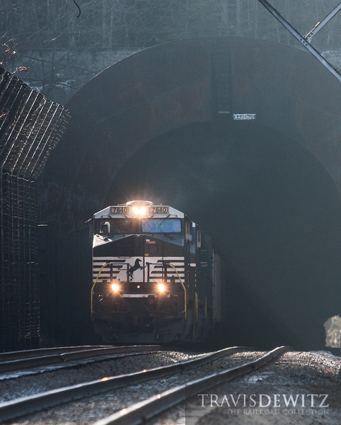 Norfolk Southern 7640 charges out of the Elkhorn Tunnel into daylight.