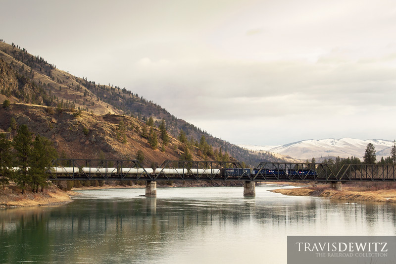 "The Montana Rail Link Gas Local, led by SD45 346, head east across the Flathead River towards Missoula after just passing through Paradise, Montana.  Travis Dewitz <a href=""http://www.therailroadcollection.com/latest-works/"" target=""_blank"">The Railroad Collection</a>"