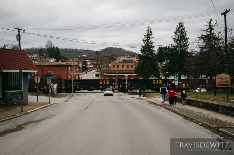 Empty CSX coal hoppers roll through Mt. Hope, West Virginia.