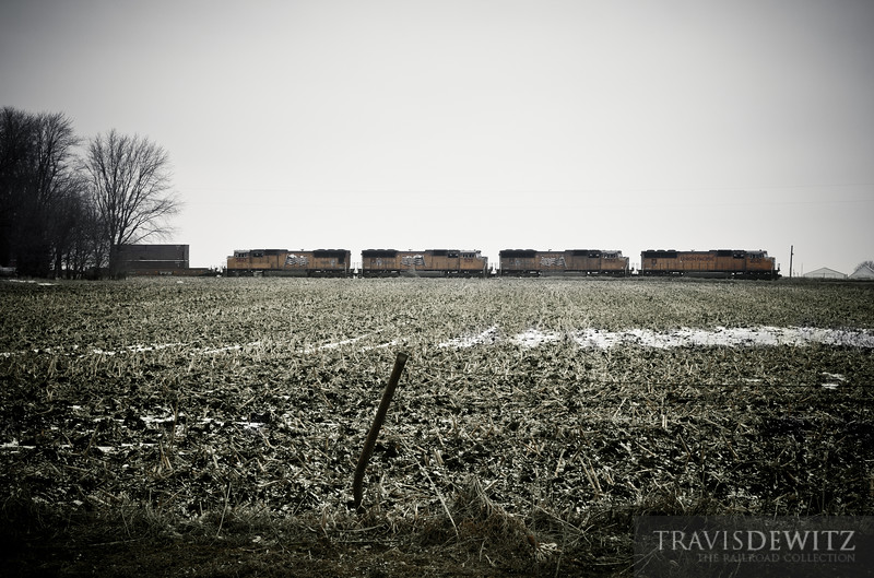 A Union Pacific stack train travels across a bleak Iowa cornfield heading to Chicago.