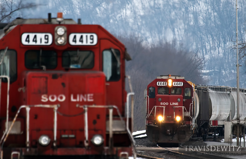 "The La Crosse, Wisconsin to Saint Pau, Minnesotal local is making its way up the Canadian Pacific River Subdivision. Soo Line 4448 leads past sister locomotive 4419 at Winona, Minnesota.  Travis Dewitz <a href=""http://www.therailroadcollection.com/latest-works/"" target=""_blank"">The Railroad Collection</a>"