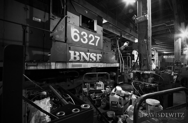 """Crews work on ex-BNSF 6327 SDP40 at the Minnesota Transportation Museum's roundhouse, getting it back into Great Northern paint.  Travis Dewitz <a href=""""http://www.therailroadcollection.com/latest-works/"""" target=""""_blank"""">The Railroad Collection</a>"""