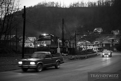 Empty Norfolk Southern coal train glides west through the old coal town of Keystone, West Virginia.  Travis Dewitz The Railroad Collection
