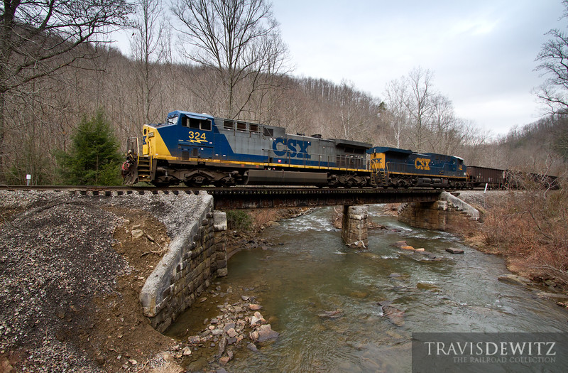 CSX 324 lead over Loup Creek handled by a RJ Corman crew heading to the Pioneer Fuel Comapany in Pax, West Virginia.