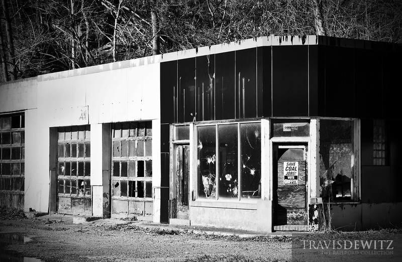 "An abandonded service station sits in disrepair in southwestern West Virginia with the only hope being a sign nailed to the door. Save Coal Jobs, Vote Griffith.  Travis Dewitz <a href=""http://www.therailroadcollection.com/latest-works/"" target=""_blank"">The Railroad Collection</a>"