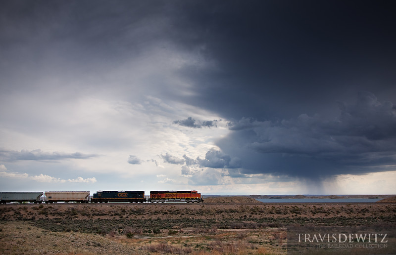 """A BNSF freight train powers west into Boysen State Park as it makes track through the Wind River Canyon towards Thermopolis, Wyoming as thunderstorms hit the area through the day and night.  Travis Dewitz <a href=""""http://www.therailroadcollection.com/latest-works/"""" target=""""_blank"""">The Railroad Collection</a>"""