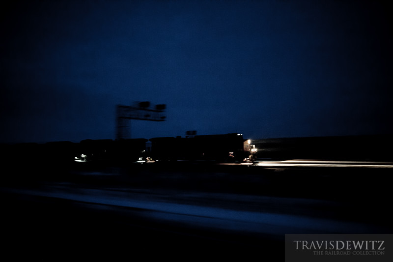Another Union Pacific coal train highballs out of the Powder River Basin as it flies east past Shawnee, Wyoming.
