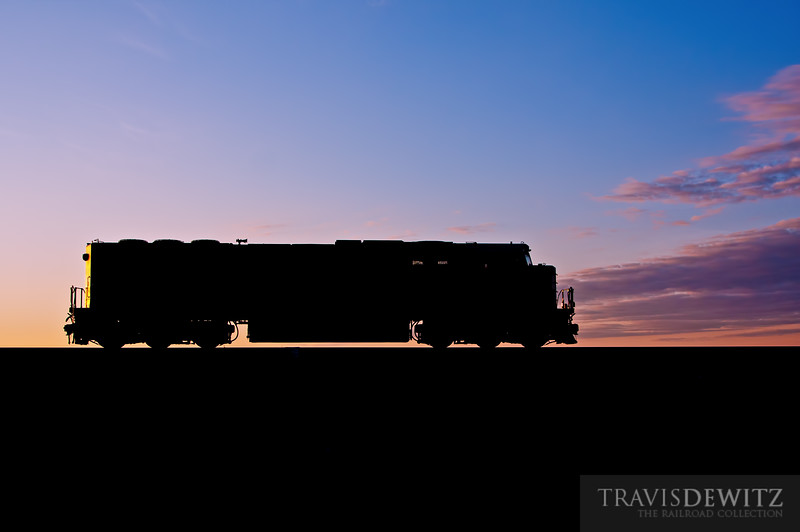 "A BNSF helper makes it way back west for the next loaded coal train as the sun rises over Theodore Roosevelt National Park near Fryburg, North Dakota.  Travis Dewitz <a href=""http://www.therailroadcollection.com/latest-works/"" target=""_blank"">The Railroad Collection</a>"