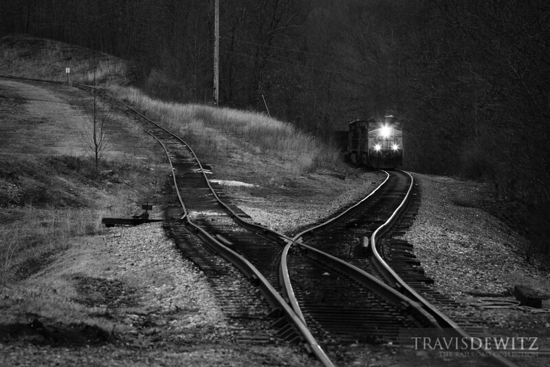 "An RJ Corman Pax coal train works up the grade out of Mt. Hope, West Virginia towards an industrial lead with a very steep grade.  Travis Dewitz <a href=""http://www.therailroadcollection.com/latest-works/"" target=""_blank"">The Railroad Collection</a>"