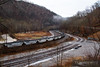 A string of loaded Top Gon coal hoppers can be seen sweeping through the curves ay Capels, West Virginia.