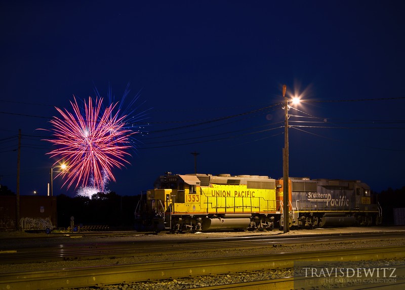 "Red, White, and Blue...and Yellow. Fireworks get shot into the sky from Lake Altoona over Union Pacific's yard in Altoona, Wisconsin where a GP40-2 and a GP60 rest.  Travis Dewitz <a href=""http://www.therailroadcollection.com/latest-works/"" target=""_blank"">The Railroad Collection</a>"