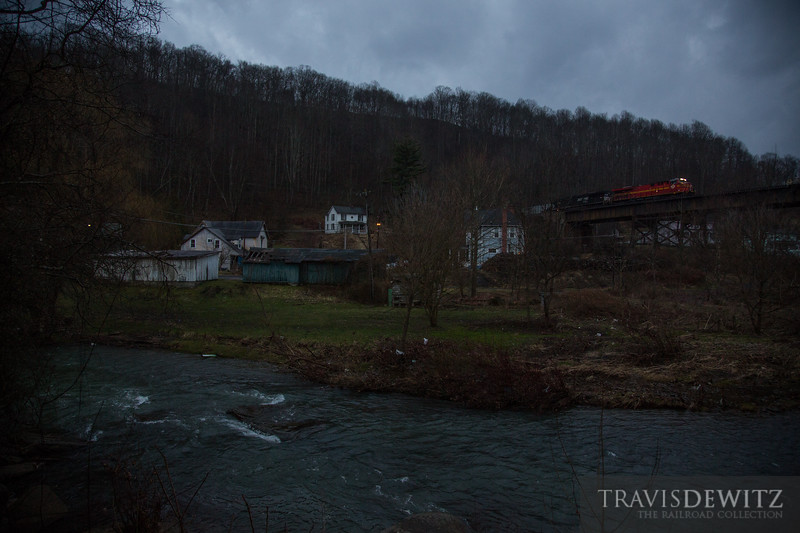 Norfolk Southern heritage unit can be seen crossing the trestle over Coopers, West Virginia at dusk.