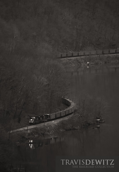 "The reflection of a westbound CSX coal train can be seen on the New River near Ansted, West Virginia.  Travis Dewitz <a href=""http://www.therailroadcollection.com/latest-works/"" target=""_blank"">The Railroad Collection</a>"