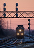 "A Union Pacific intermodal train heads west at sunset through West Chicago, Illinois under a signal bridge.  Travis Dewitz <a href=""http://www.therailroadcollection.com/latest-works/"" target=""_blank"">The Railroad Collection</a>"